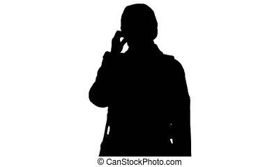 Silhouette Girl in a medical face mask standing in a coat.