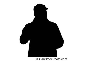 Silhouette Good looking man talking to camera and walking....