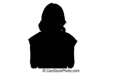 Silhouette Smiling woman with tablet computer presenting...