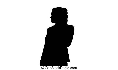 Silhouette Young business woman listening to music on the phone and dancing to it.