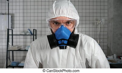 Mad doctor in protective suit looking to camera and ...