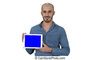 Smiling casual man presenting a tablet with a blank screen on white background.