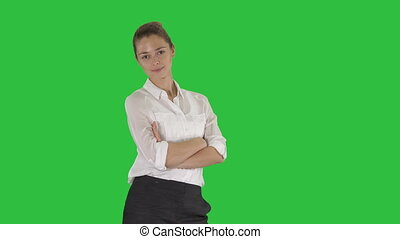 Thoughtful woman with crossed hands on a Green Screen, Chroma Key.