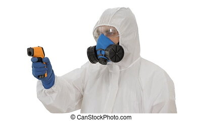 Doctor using infrared forehead thermometer gun to check body temperature for virus covid-19 symptoms on white background.