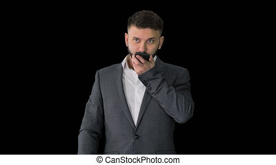 Medium shot. Turk businessman using smartphone's digital voice assistant, Alpha Channel. Professional shot in 4K resolution. 044. You can use it e.g. in your medical, commercial video, business, presentation, broadcast