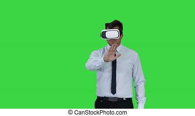 Businessman in VR glasses and interacting with virtual...