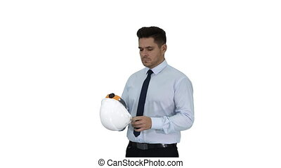 Medium shot. Walking in and out of the frame. Businessman putting hardhat helmet on Safety on white background. Professional shot in 4K resolution. 018. You can use it e.g. in your commercial video, business, presentation, broadcast