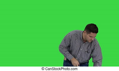 Floor care and cleaning services Casual man cleaning the floor and showing thumb up gesture on a Green Screen, Chroma Key.