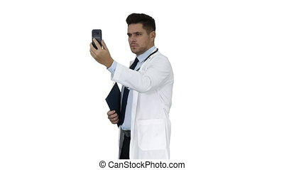 Male doctor making a video call talking to his patient on white background.