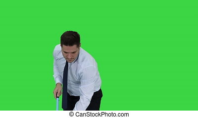 Man with thumb up holding broom in formal clothes or...