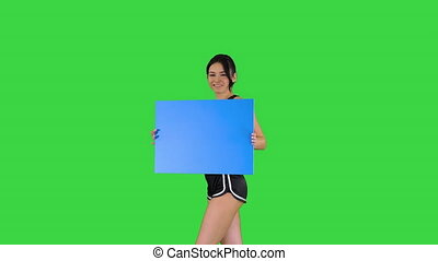 Medium shot. Walking in and out of the frame. Ring girl holding empty board announcing new round on a Green Screen, Chroma Key. Professional shot in 4K resolution. 021. You can use it e.g. in your commercial video, business, presentation, broadcast
