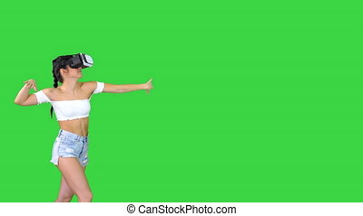 Woman using VR Virtual Reality headset walking and dancing ...