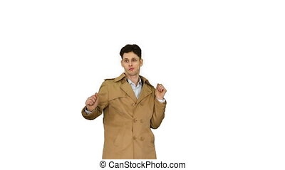 Young man wearing trench coat dancing and having fun on white background.