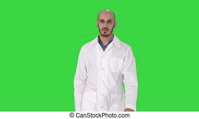 Walking male arab doctor on a Green Screen, Chroma Key.