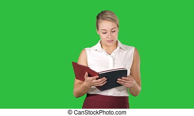 Woman hold and open book or notebook reading something out...