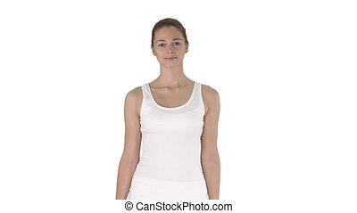Woman in blank white tank top walking and showing on...