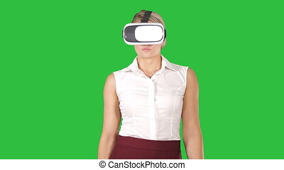 Woman with VR headset glasses device Virtual reality concept on a Green Screen, Chroma Key.