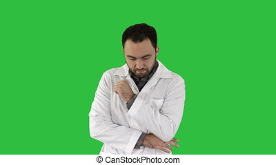 Yawning doctor with hand covering mouth, tired, stressed on a Green Screen, Chroma Key.