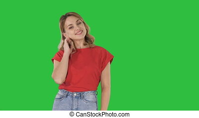 Young attractive happy model standing and smiling on a Green Screen, Chroma Key.