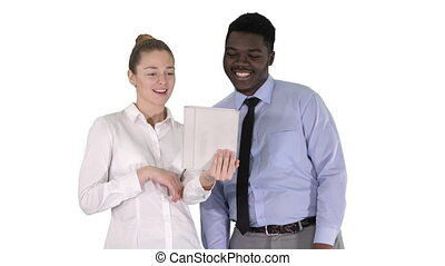 Young caucasian businesswoman and her african colleague making video call with tablet on white background.
