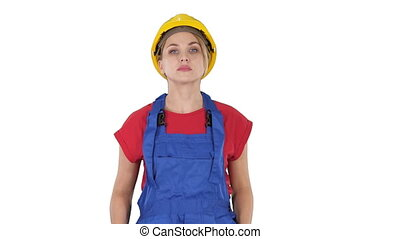 Young construction woman in hardhat walking on white...