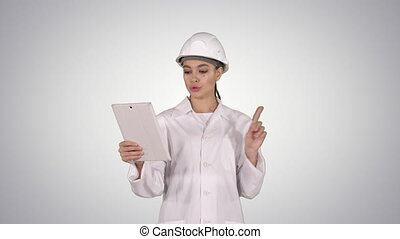 Young Female Scientist Making Video Call With Tablet on...