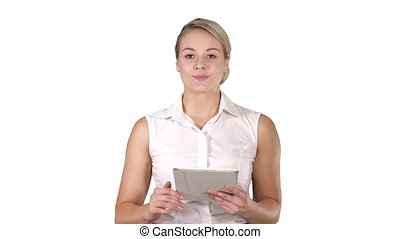 Young smiling business woman with tablet computer turning pages and looking in to the camera on white background.