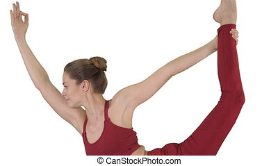Young sporty attractive woman practicing yoga on white background.