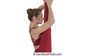 Young woman show perfect split on white background. - Medium...