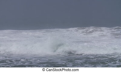 Medium Sized Waves in Bay - Steady, medium close up shot of...