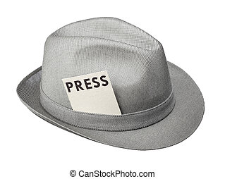 Vintage trilby hat with press pass isolated on white