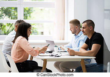 Meeting Business At Conference Table