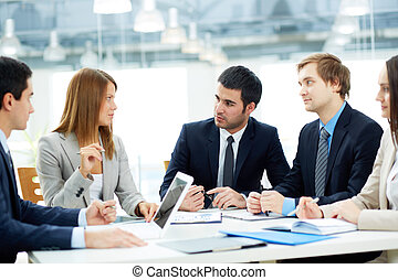 Meeting - Image of business partners listening to female...
