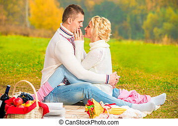 meeting loving couple in the park on a picnic