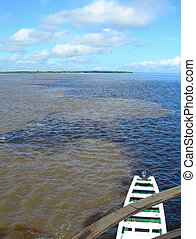 Meeting of Amazon and Rio Negro, Brazil - Boat at the...