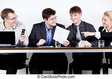 Meeting of entrepreneurs - Four entrepreneurs are sitting at...