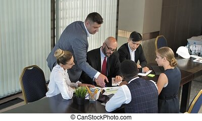Meeting of managers of a large company in slow moion -...
