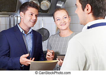 Meeting Of Restaurant Team In Kitchen