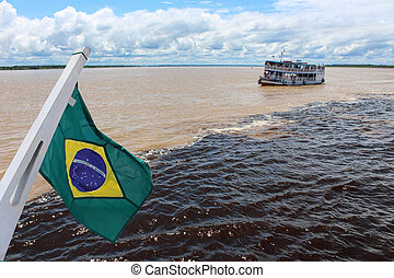 Meeting of the waters of Rio Negro and Amazon River with...