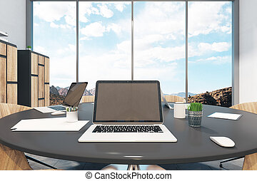 Meeting room with laptop