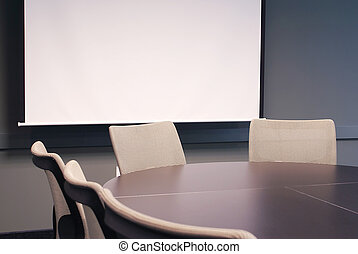 Meeting room with white sreen.