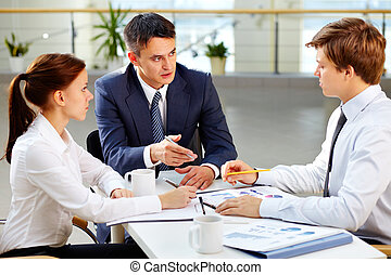 Meeting with boss - Serious business people giving a report...