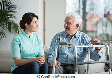 Meeting with nurse - Elderly sick man meeting with his young...