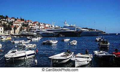 Mega yachts - Four mega, super yachts on dock in harbor in...