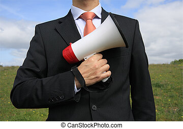 Megaphone - Businessman with a black suit holding a...