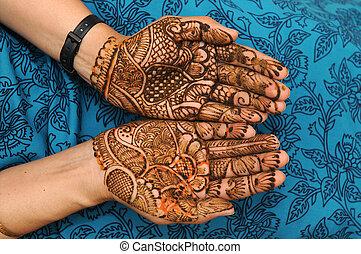 mehandi - a design on hands against a black background
