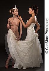 Mehandi art. Shot of sensual brides posing in pair - Mehandi...