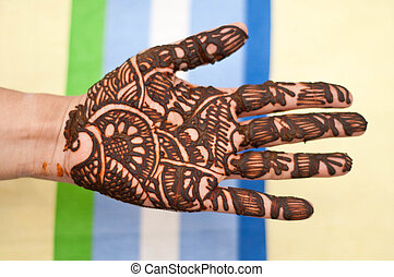 Mehandi - hands beautifully decorated with colorful herbs