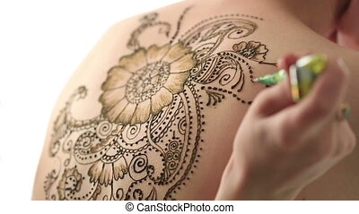 Mehendi. Creating beautiful patterns with henna, close-up