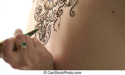 Mehendi. Creating complex pattern on model's back - Mehendi....